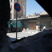 August 14, 2012 - Aleppo, Syria: Free Syria Army (FSA) fighters lys sand bags in preparation for a snipper position in Babal Nassar neighborhood in Aleppo's old city. The Syrian Army have in the past ten days increased their attacks on residential neighborhoods where Free Syria Army rebel fights have their positions in Syria's commercial capital, Aleppo. (Paulo Nunes dos Santos/Polaris)