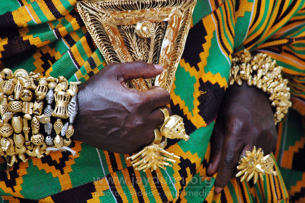Ghana, Accra, 2007. Ashanti gold beckons in the aftenooon light. Costumed actors played some of Ghana's best-known historical figures.