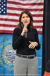 Congresswoman Kristi Noem at J and L Harley-Davidson just before the unveiling of a 2018 Harley-Davidson Street Glide donated by the Motor Company and painted by J and L to commemorate the christening of the USS South Dakota submarine. Sioux Falls, SD. USA. Monday October 9, 2017. Photography ©2017 Michael Lichter.
