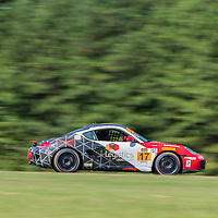 Alton, VA - Aug 26, 2016:  The RS1 Logistics Porsche Cayman races through the turns at the Oak Tree Grand Prix at Virginia International Raceway in Alton, VA.