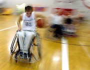 Wheelchair basketball player Derrick Lee drives down the lane on his way to another basket.