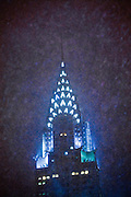 The Chrysler Building in New York City at night seen through a snowstorm.