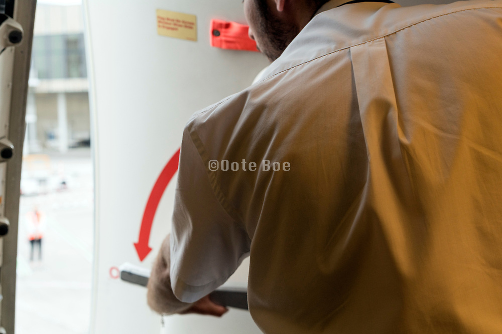 opeing or closing of a commercial passenger airplane door by stuward