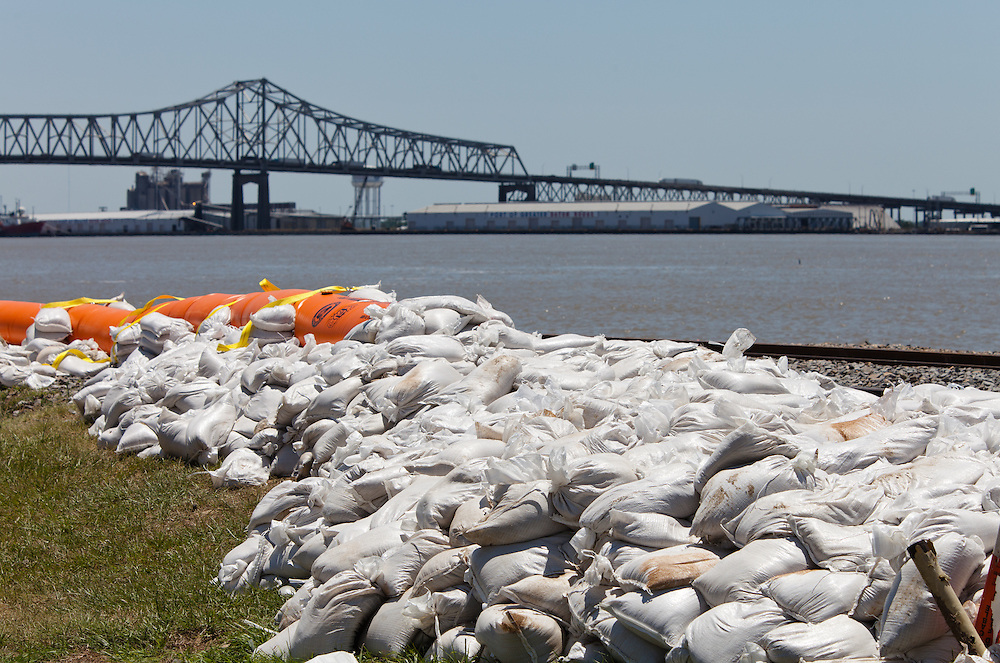 The  Morganza spillway was opened on May 14th for the first time since 1973 in order to protect Baton Rouge and new Orleans from flooding.  The opening of the spillway will cause property damage to those living in the Atchafalaya Basin by diverting water from the Mississippi River allowing it to flow through the Morganza floodway to the Gulf of Mexico. <br /> /// Sandbags and a berm line  top of the levy along the  Mississippi River in Baton Rouge, Louisiana to protect the city from flooding.
