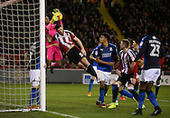 Jack O'Connell of Sheffield Utd challenges Lawrence Vigouroux of Swindon Town  during the English League One match at Bramall Lane Stadium, Sheffield. Picture date: December 10th, 2016. Pic Simon Bellis/Sportimage