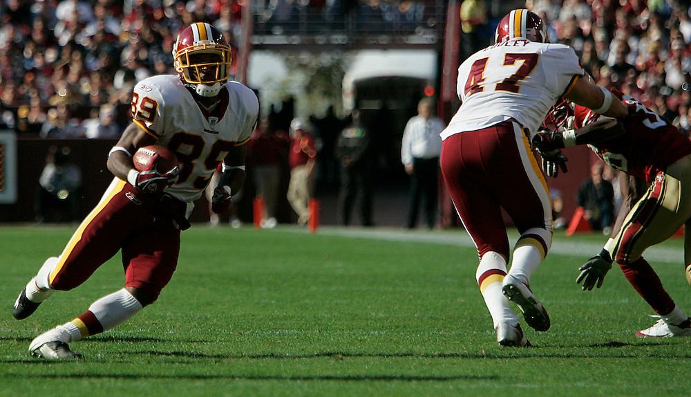 Jay Westcott/Examiner     SP   Oct. 23, 2005 - Washington Redskins vs. San Francisco 49ers. - #89 Santana Moss finds the open field after Chris Cooley makes a key block.