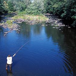 Fly fishing on the Lamprey River, just below the Lee-Hook Rd. Bridge.  Lee, NH