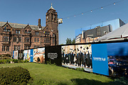 Coventry University hoarding and preparations for the a substantial new hub venue in the city centre, Assembly Festival Garden and will be a centrepiece for the city's year of cultural celebrations and will run from 1 July to mid-October for the UK City of Culture 2021 on 23rd June 2021 in Coventry, United Kingdom. The UK City of Culture is a designation given to a city in the United Kingdom for a period of one year. The aim of the initiative, which is administered by the Department for Digital, Culture, Media and Sport. Coventry is a city which is under a large scale and current regeneration.