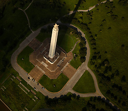 Aerial view of San Jacinto Monument showcased by dramatic light at Port of Houston in Texas.