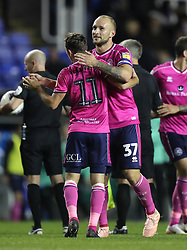 Queens Park Rangers's Toni Leistner (right) and Josh Scowen celebrate their side's win after the Sky Bet Championship match between Reading and Queens Park Rangers.