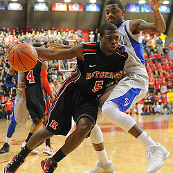 Rutgers Scarlet Knights guard Eli Carter (5) drives to the basket against Seton Hall Pirates guard/forward Fuquan Edwin (23) during second half Big East NCAA Basketball between the Rutgers Scarlet Knights and Seton Hall Pirates at the Louis Brown Athletic Center. Seton Hall defeated Rutgers 59-55.