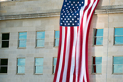 September 11, 2016 - Arlington, United States of America - A giant American flag flies on the spot where the terror attack hit the Pentagon during a ceremony commemorating the 15th anniversary of the 9/11 terrorist attacks at the Pentagon September 11, 2016 in Arlington, Virginia. (Credit Image: © Ej Hersom/Planet Pix via ZUMA Wire)