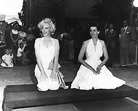 1953 Marilyn Monroe and Jane Russell at their hand and footprint ceremony at Grauman's Chinese Theater