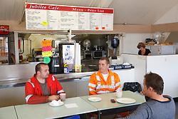 Men in dockside cafe