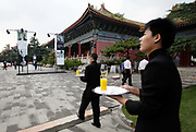 Waiters serve drinks during a corporate event held at theimperial ancestral temple, or Tai Miao, next to the forbidden palace in Beijing, China on 23 August 2012.