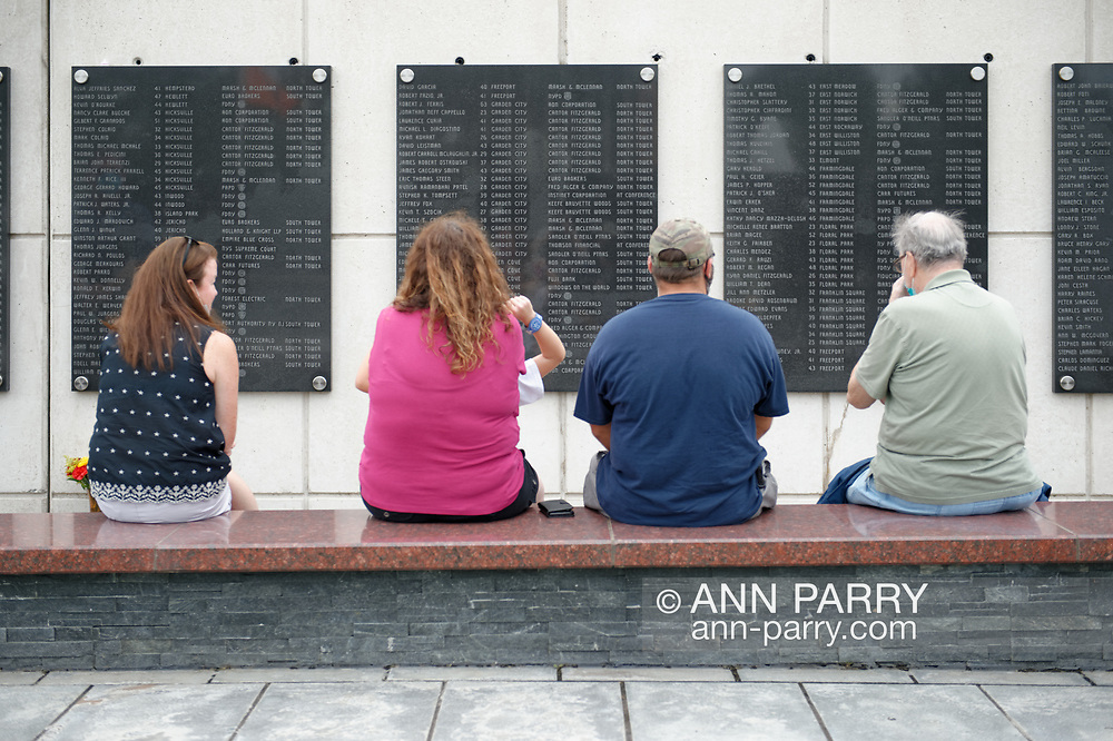 East Meadow, New York, U.S. September 10, 2020. At far left, TRICIA DEAN, widow of William T. Dean, of Floral Park, who died during terrorist attack on Twin Towers, sits at Nassau County Eisenhower Park September 11, 2001 Memorial, on bench across from plaque where her husband's name is listed among 348 county residents killed by the attacks.