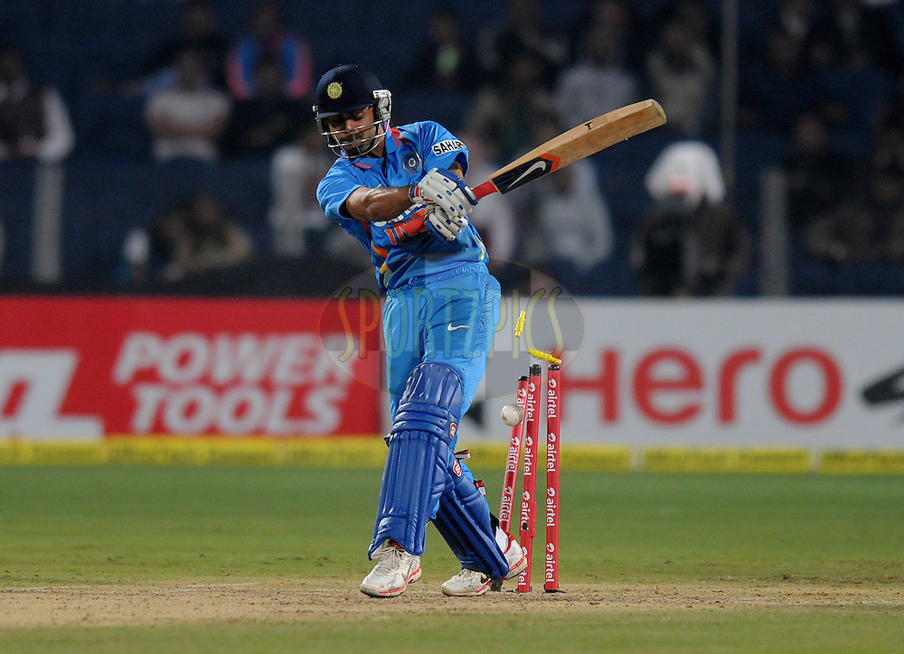 Virat Kohli of India gets bowled out by Stuart Meaker of England during the first Airtel T20 Match between India and England held at Subrata Roy Sahara stadium in Pune on the  20th December 2012..Photo by  Pal Pillai/BCCI/SPORTZPICS .