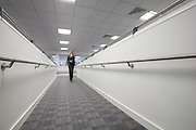 A woman walks down the split level ramp