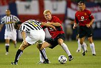 Photo Aidan Ellis.<br />Manchester United v juventus (Champions World Match at New York Giants Stadium East Rutherford).31/07/03.<br />United's Paul Scholes and Juve's Ciro Ferrara tangle