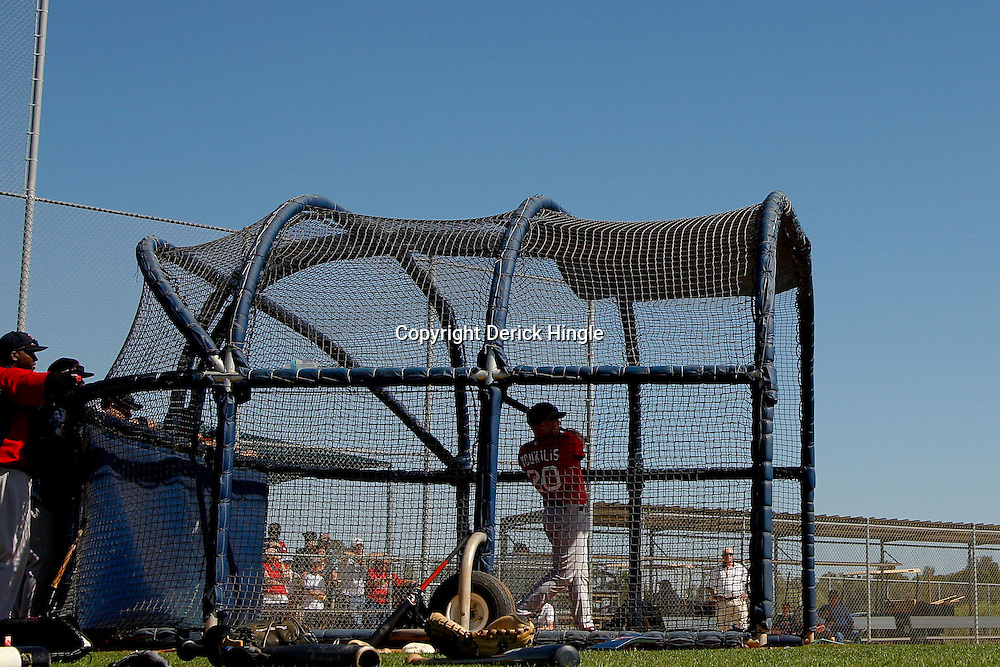 February 23, 2011; Fort Myers, FL, USA; Boston Red Sox third baseman Kevin Youkilis (20) hits the ball in a batting practice session during spring training at the Player Development Complex.  Mandatory Credit: Derick E. Hingle