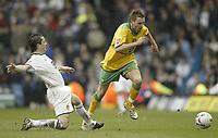 Photo: Aidan Ellis.<br /> Leeds United v Norwich City. Coca Cola Championship. 11/03/2006.<br /> Leeds Gary Kelly challenges Norwich's Darren Huckerby