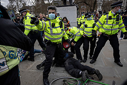 © Licensed to London News Pictures. 03/04/2021. London, UK. Police push protesters away as an arrest is made in front of the Winston Churchill statue in Parliament Square during a 'Kill the Bill' protest. Protests have been held across the UK in opposition to the Police, Crime, Sentencing and Courts Bill which would broaden police powers when dealing with protests. Photo credit: Rob Pinney/LNP