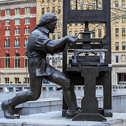Philadelphia, PA - January 1, 2016: Sculpture of Benjamin Franklin at the printing press in Philadelphia.