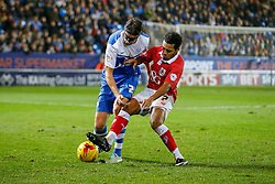 Christian Burgess of Peterborough United is challenged by Korey Smith of Bristol City - Photo mandatory by-line: Rogan Thomson/JMP - 07966 386802 - 28/11/2014 - SPORT - FOOTBALL - Peterborough, England - ABAX Stadium - Peterborough United v Bristol City - Sky Bet League 1.