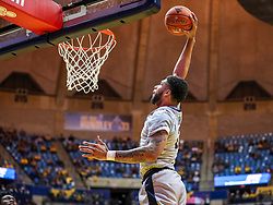 Dec 1, 2018; Morgantown, WV, USA; West Virginia Mountaineers forward Esa Ahmad (23) dunks the ball during the second half against the Youngstown State Penguins  at WVU Coliseum. Mandatory Credit: Ben Queen-USA TODAY Sports