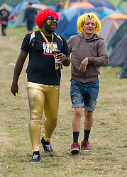 © Licensed to London News Pictures. 05/09/2014. Isle of Wight, UK. Festival goers wearing fancy dress  in the campsite of Bestival 2014 Day 2 Friday.  This weekend's headliners include Chic featuring Nile Rodgers, Foals and Outcast Photo credit : Richard Isaac/LNP