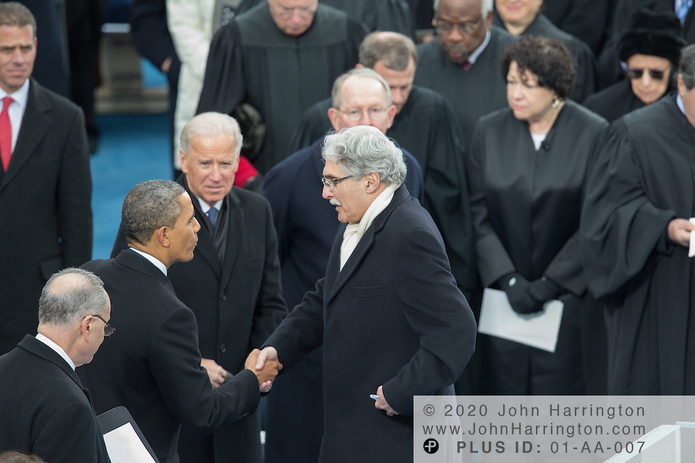 Rev. Luis Leon is congratulated by President Barack Obama at the conclusion of her benediction during the 57th Presidential Inauguration of President Barack Obama at the U.S. Capitol Building in Washington, DC January 21, 2013.