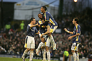 Roger Johnson of Cardiff city (c) celebrates his goal with Wayne Routledge (l) and Jay Bothroyd (r). Coca Cola championship, Cardiff City v Sheffield Wednesday at Ninian Park, Cardiff on Sat 20th Dec 2008. pic by Andrew Orchard, Andrew Orchard sports photography,