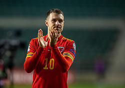 TALLINN, ESTONIA - Monday, October 11, 2021: Wales' captain Aaron Ramsey applauds the supporters after the FIFA World Cup Qatar 2022 Qualifying Group E match between Estonia and Wales at at the A. Le Coq Arena. Wales won 1-0. (Pic by David Rawcliffe/Propaganda)