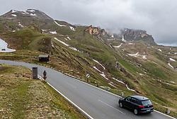 THEMENBILD - ein Auto fährt Bergwärts auf der Strasse vor dem Bergpanorama. Die Grossglockner Hochalpenstrasse verbindet die beiden Bundeslaender Salzburg und Kaernten mit einer Laenge von 48 Kilometer und ist als Erlebnisstrasse vorrangig von touristischer Bedeutung, aufgenommen am 5. Juni 2017, Fusch a. d. Glocknerstrasse, Oesterreich // A car drives uphill on the road in front of the mountain panorama. The Grossglockner High Alpine Road connects the two provinces of Salzburg and Carinthia with a length of 48 km and is as an adventure road priority of tourist interest at Fusch a. d. Glocknerstrasse, Austria on 2017/06/05. EXPA Pictures © 2017, PhotoCredit: EXPA/ JFK