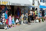 Tourists shopping for souvenirs, village of Bol, island of Brac, Croatia