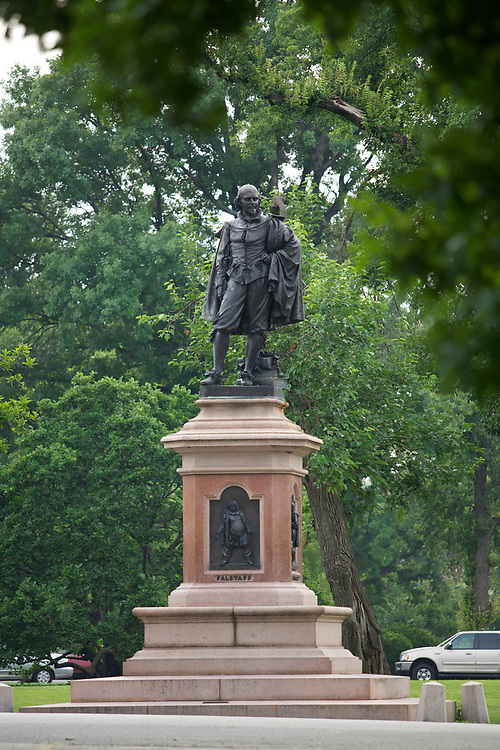 A statue of William Shakespeare in Tower Grove Park in St. Louis, Missouri on July 1, 2007.  At the base of the pedestal is a bronze relief of Falstaff, a character in several of Shakespeare's plays. The sculptor was Ferdinand Von Miller from Germany.