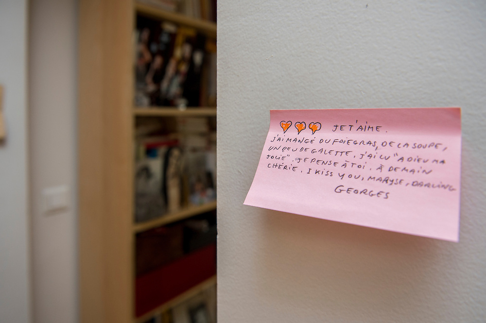 """March 6, 2015, Paris, France. Post-it notes decorate the Paris' apartment where Georges and Maryse Wolinski used to live. French Cartoonist Georges Wolinski (1934 –2015) wrote daily post-it notes to his wife Maryse Wolinski (1943, Algiers). Two month after the death of Georges Wolinski, the apartment is full of souvenirs and notes, attesting a half-century-long love relation: """"I love you, I've eaten foie gras, soup, some cake, I read in """"Adieu ma Jolie"""". I think of you, until tomorrow darling. I kiss you, Maryse, darling. Georges."""" <br /> The cartoonist Georges Wolinski was 80 years old when he was murdered by the French jihadists Chérif en Saïd Kouachi, he was one of the 12 victim<br /> s of the massacre in the Charlie Hebdo offices on January 7, 2015 in Paris. Charlie Hebdo published caricatures of Mohammed, considered blasphemous by some Muslims. During his life, Georges Wolinski defended freedom, secularism and humour and was one of the major political cartoonists in France. The couple was married and had lived for 47 years together. Photo: Steven Wassenaar."""