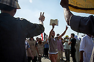 A man holding a copy of the Koran at a Muslim Brotherhood demonstration in Nassr City, Cairo