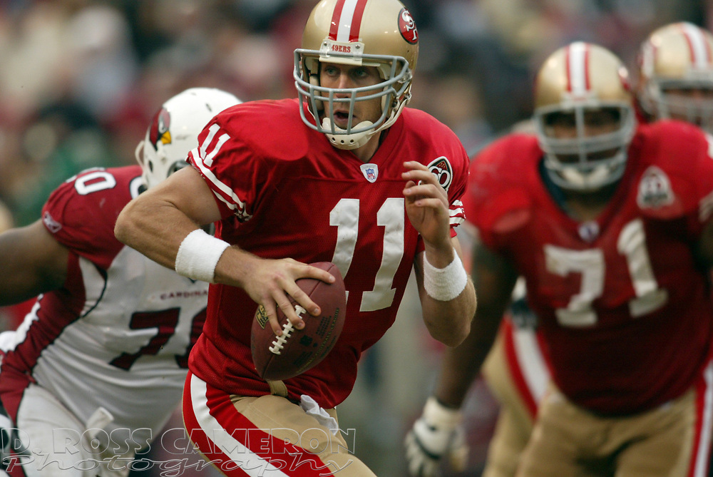 San Francisco 49ers quarterback Alex Smith (11) looks for a receiver in the third quarter of their NFL football game against the Arizona Cardinals, Sunday, Dec. 24, 2006 at Candlestick Park in San Francisco.  The Cardinals won, 26-20. (D. Ross Cameron/The Oakland Tribune)