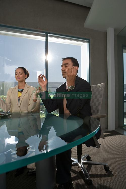Dec. 05, 2012 - Business people meditating (Credit Image: © Image Source/ZUMAPRESS.com)