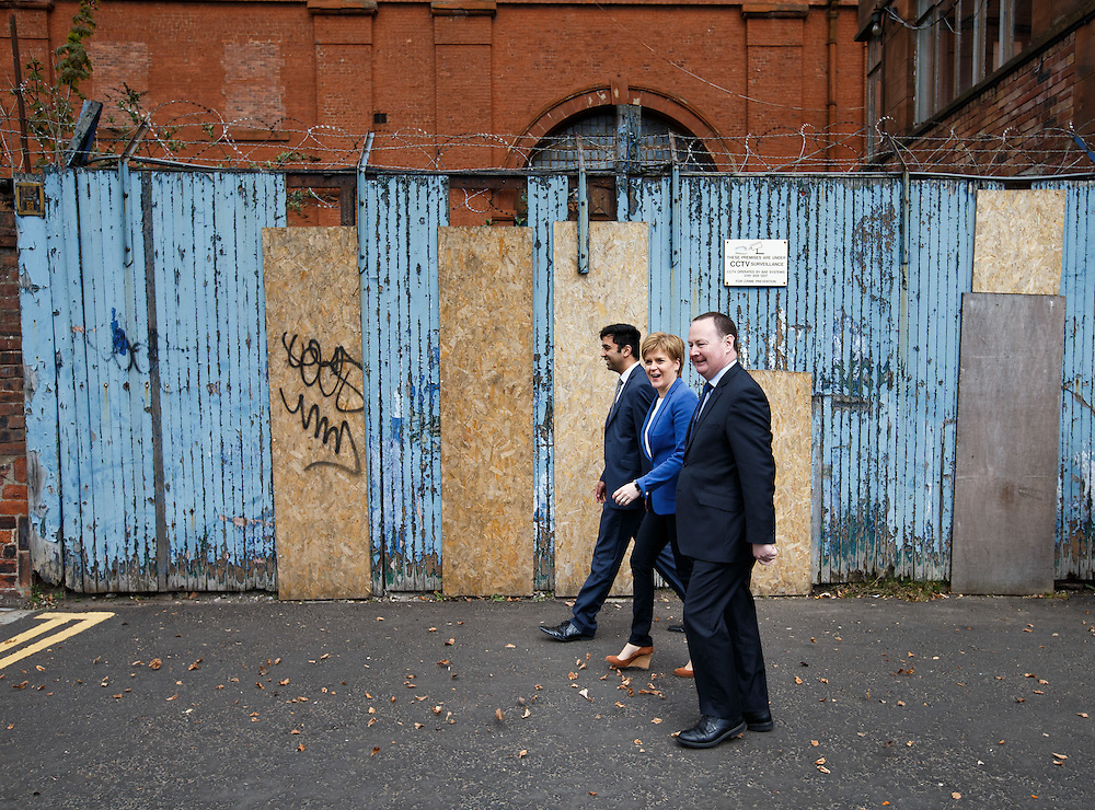FIRST MINISTER STURGEON TO MEET WORKFORCE AT GOVAN SHIPYARD. Nicola Sturgeon (C) walking along Govan Rd, Glasgow to meet workers at the BAE Shipyard in Govan.  With local candidates Humza Yousaf (L) and Bill Kidd (R).  Picture Robert Perry 25th April 2016<br /> <br /> Must credit photo to Robert Perry<br /> FEE PAYABLE FOR REPRO USE<br /> FEE PAYABLE FOR ALL INTERNET USE<br /> www.robertperry.co.uk<br /> NB -This image is not to be distributed without the prior consent of the copyright holder.<br /> in using this image you agree to abide by terms and conditions as stated in this caption.<br /> All monies payable to Robert Perry<br /> <br /> (PLEASE DO NOT REMOVE THIS CAPTION)<br /> This image is intended for Editorial use (e.g. news). Any commercial or promotional use requires additional clearance. <br /> Copyright 2014 All rights protected.<br /> first use only<br /> contact details<br /> Robert Perry     <br /> 07702 631 477<br /> robertperryphotos@gmail.com<br /> no internet usage without prior consent.         <br /> Robert Perry reserves the right to pursue unauthorised use of this image . If you violate my intellectual property you may be liable for  damages, loss of income, and profits you derive from the use of this image.