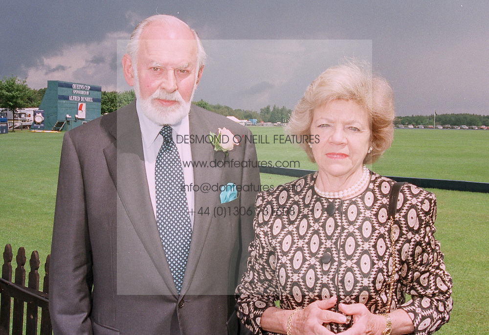 MR & MRS RICHARD DUNHILL chairman of Dunhill, at a luncheon in Berkshire on 22nd June 1997.LZN 1