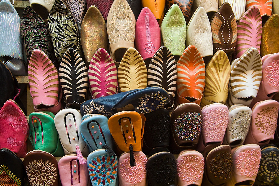 Colorful Moroccan leather oriental slippers (babouches) are on display and for sale at a market stall along the streets of the Marrakech medina, Morocco on November 15, 2007.