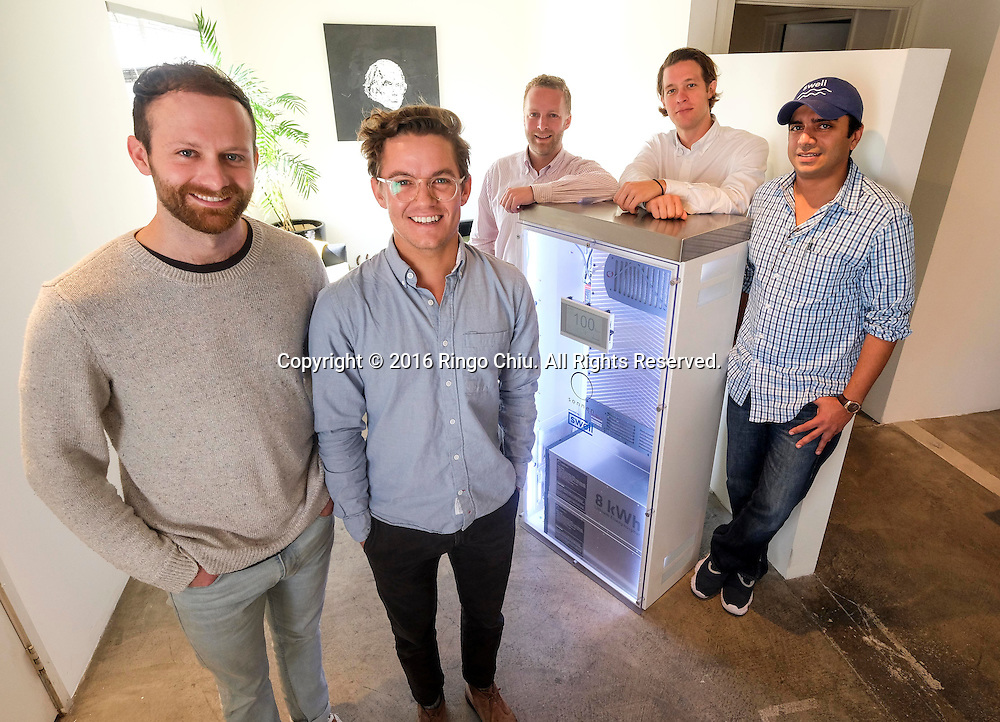 From left to right, Andrew Meyer, Tyler Gaul, Ken Lawshe, Matt Riging and Suleman Khan, partner of Swell Energy with a Sonnen battery.(Photo by Ringo Chiu/PHOTOFORMULA.com)<br /> <br /> Usage Notes: This content is intended for editorial use only. For other uses, additional clearances may be required.
