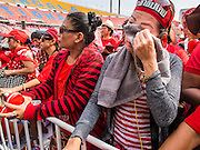 20 NOVEMBER 2013 - BANGKOK, THAILAND: A Red Shirt supporter weeps when it was announced that the Thai Constitutional Court would not disband the government. Thousands of Red Shirts, supporters of the Pheu Thai ruling party in Thailand, gathered in Rajamangala Stadium in suburban Bangkok to listen to the Thai Constitutional Court deliver its verdict against the government. The court ruled that the recent efforts by the government to pass a blanket amnesty bill violated the Thai Constitution but the court did not order the party to disband or the dissolution of the government, which had been widely feared.     PHOTO BY JACK KURTZ