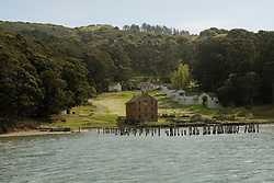 Camp Reynolds, Angel Island State Park, in San Francisco Bay, CA, California.  People disembark and picnic at Ayala Cove, then hike, bike, or tram perimeter road, with stops at Civil War era Camp Reynolds, and its restored officer house, or Spanish American War era Fort McDowell..Photo camari242-70333..Photo copyright Lee Foster, www.fostertravel.com, 510-549-2202, lee@fostertravel.com.