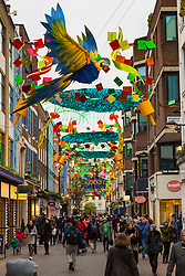 London, December 24 2017. Crowds grow in London's west end on Christmas eve as last minute shoppers hunt for gifts PICTURED: Shoppers enjoy the tropical themed decorations in Carnaby Street. © SWNS