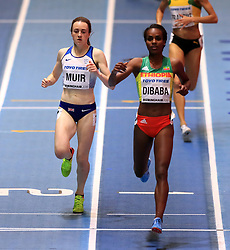 Great Britain's Laura Muir (left) on her way to finishing second in the Women's 1500m Heat 1 behind winner Ethiopia's Genzebe Dibaba during day two of the 2018 IAAF Indoor World Championships at The Arena Birmingham.