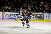 KELOWNA, CANADA - OCTOBER 18:  Madison Bowey #4 of the Kelowna Rockets and Daulton Siwak #12 of the Prince George Cougars skate on the ice as the Prince George Cougars visit the Kelowna Rockets on October 18, 2012 at Prospera Place in Kelowna, British Columbia, Canada (Photo by Marissa Baecker/Shoot the Breeze) *** Local Caption ***