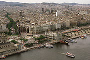 Aerial of Barcelona with the port and Las Ramblas, a tree-lined street that runs through the heart of the Gothic Quarter, starting at the port's monument to Christopher Columbus. Barcelona, Spain.